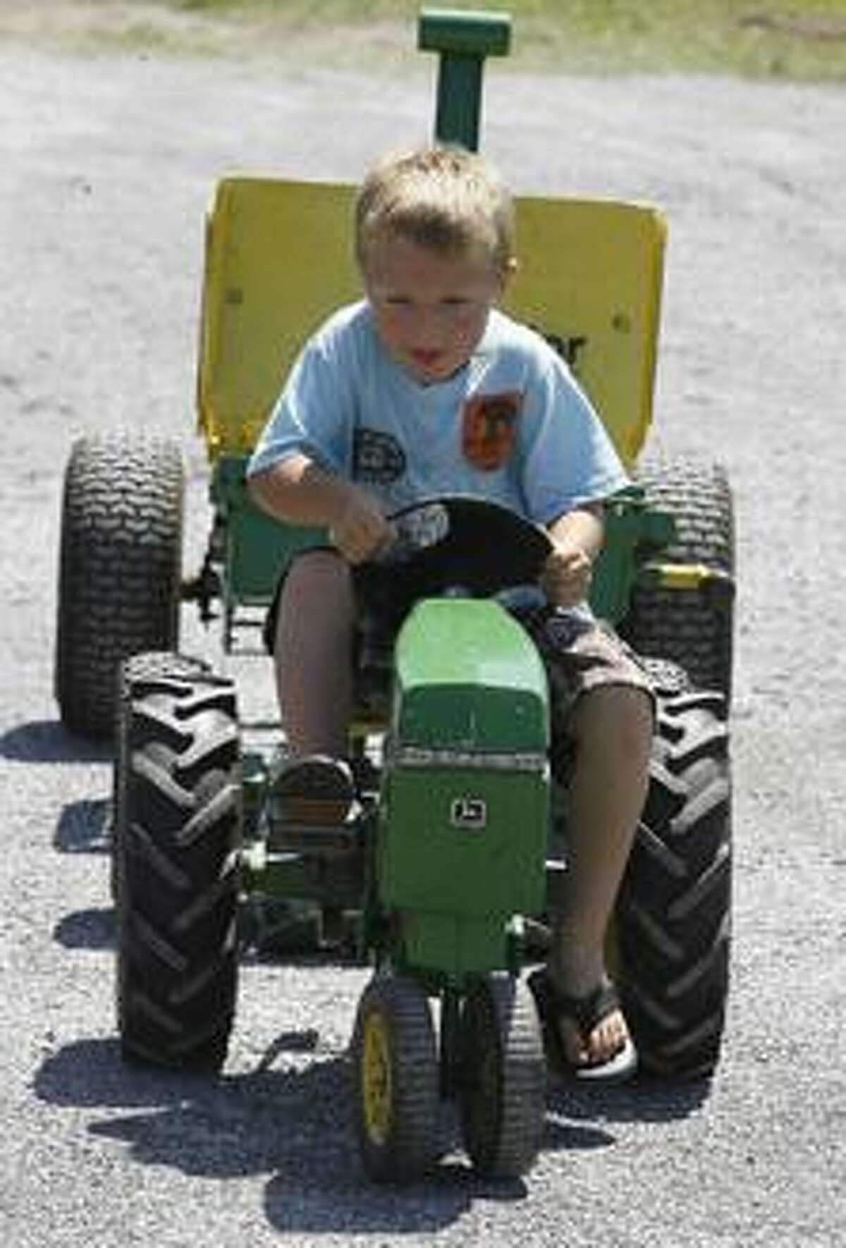 Dispatch Staff Photo by JOHN HAEGERtwitter.com/oneidaphotoKaden Wilson ,5, of Munnsville works to pull the sled 25 feet during the peddle tractor pull contest test at the 17th annual Ruritan Community Fair in Munnsville on Saturday, July 30, 2011.