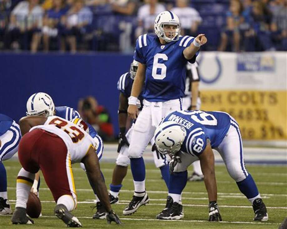In this Aug. 19, 2011, photo, Indianapolis Colts quarterback Dan Orlovsky (6) points to a defender the fourth quarter of an NFL preseason football game against the Washington Redskins in Indianapolis. All Orlovsky wants to do is win. After making seven NFL starts in seven seasons and losing all seven times, Orlovsky will get another shot Sunday at New England, as the winless Colts take on the Patriots. (AP Photo/Michael Conroy) Photo: AP / AP2011