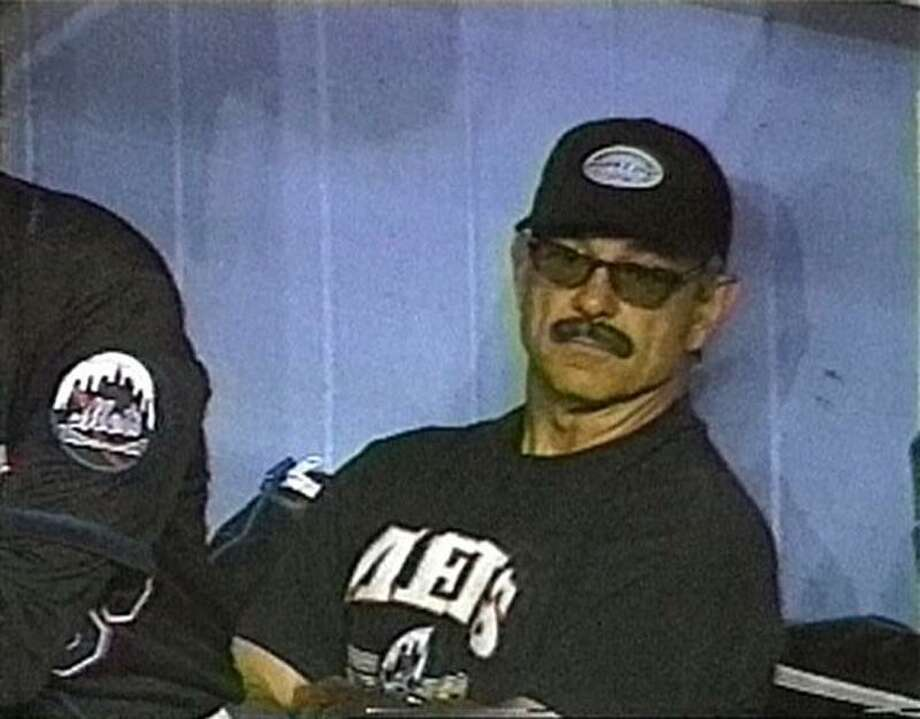 FILE - In this June 9, 1999, file photo, New York Mets manager Bobby Valentine wears a fake mustache and glasses in the dugout after he was ejected in the 12th inning of a baseball game against the Toronto Blue Jays in this image made from television  in New York. A person familiar with the negotiations says the Boston Red Sox have agreed to terms with Bobby Valentine on a contract that will make him the team's new manager. Valentine returned from a trip to Japan on Wednesday, Nov. 30, 2011 and is expected to be introduced at Fenway Park on Thursday, said the person, who spoke on the condition of anonymity because the deal had not yet been signed. (AP Photo/ESPN, File Photo: AP / ESPN