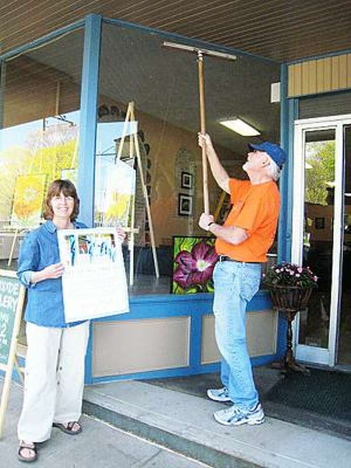 SUBMITTED PHOTO Window-washing artists clean Hamilton businesses on Broad Street.