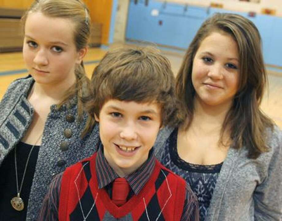 Photo by JOHN HAEGER (Twitter.com/OneidaPhoto)  Otto Shortell Middle School seventh grader Tanner Williams, center, poses with second place finisher Jadah Gann, left, and third place finisher Alicia Ayers following the annual Oneida City School District 2011 Spelling Bee on Tuesday, Nov. 29, 2011 held at the school in Wampsville.