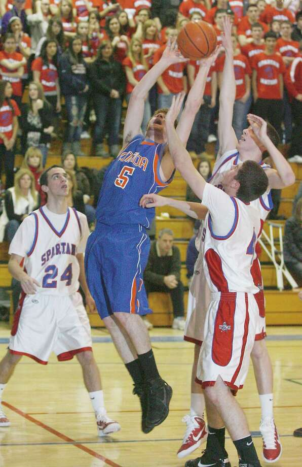 Dispatch Staff Photo by JOHN HAEGER Oneida 's Kyle Peck  (5) goes up for two in first round sectional game against New Hartford in New Hartford  on February 26, 2011. The junior averaged 16 ppg. last season.