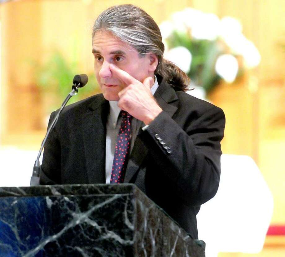 Jack Gambardella, Amy O'Neill's closest friend, delivers a eulogy for O'Neill at St. Rita Church in Hamden Saturday. Arnold Gold/Register