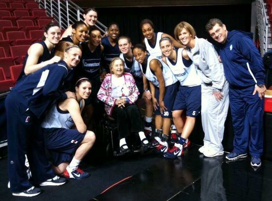 Joan Lewis with the University of Connecticut women's basketball team before their win over Duke.