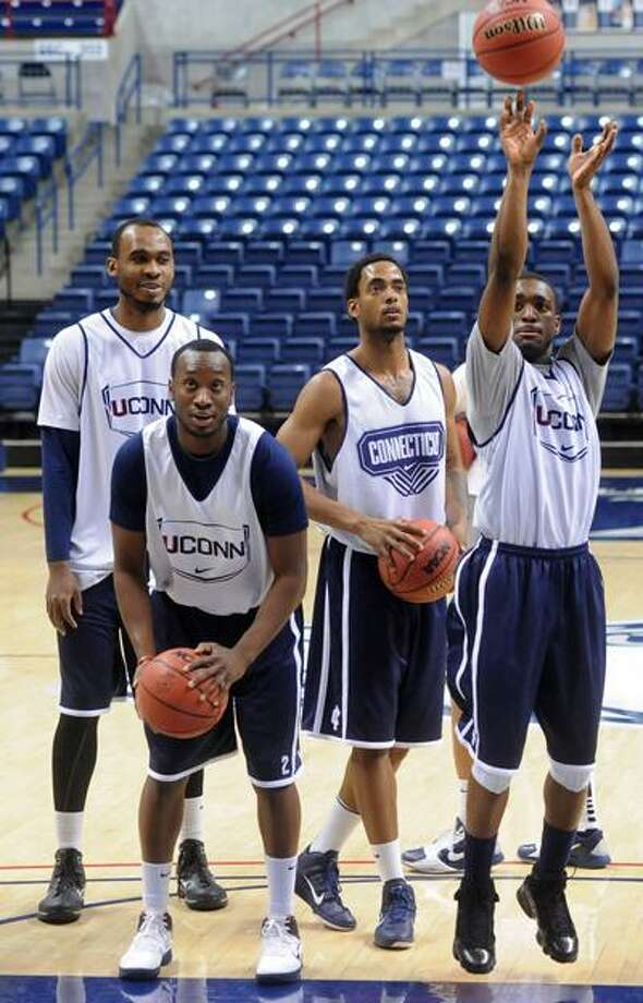 Storrs--UConn players (left to right) Charles Okwandu, Donnell Beverly, Jamal Coombs-McDaniel and Kemba Walker during practice at Gampel Pavilion Tuesday.  Photo by Brad Horrigan/New Haven Register-03.29.11.