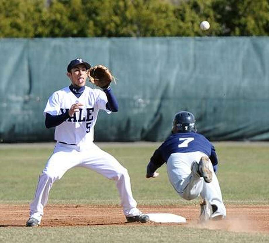 New Haven-- Quinnipiac's Mickey Amanti steals second base as Yale's Matt Schmidt waits for the throw. Photo by Peter Casolino/New Haven Register03/30/11 Cas110330
