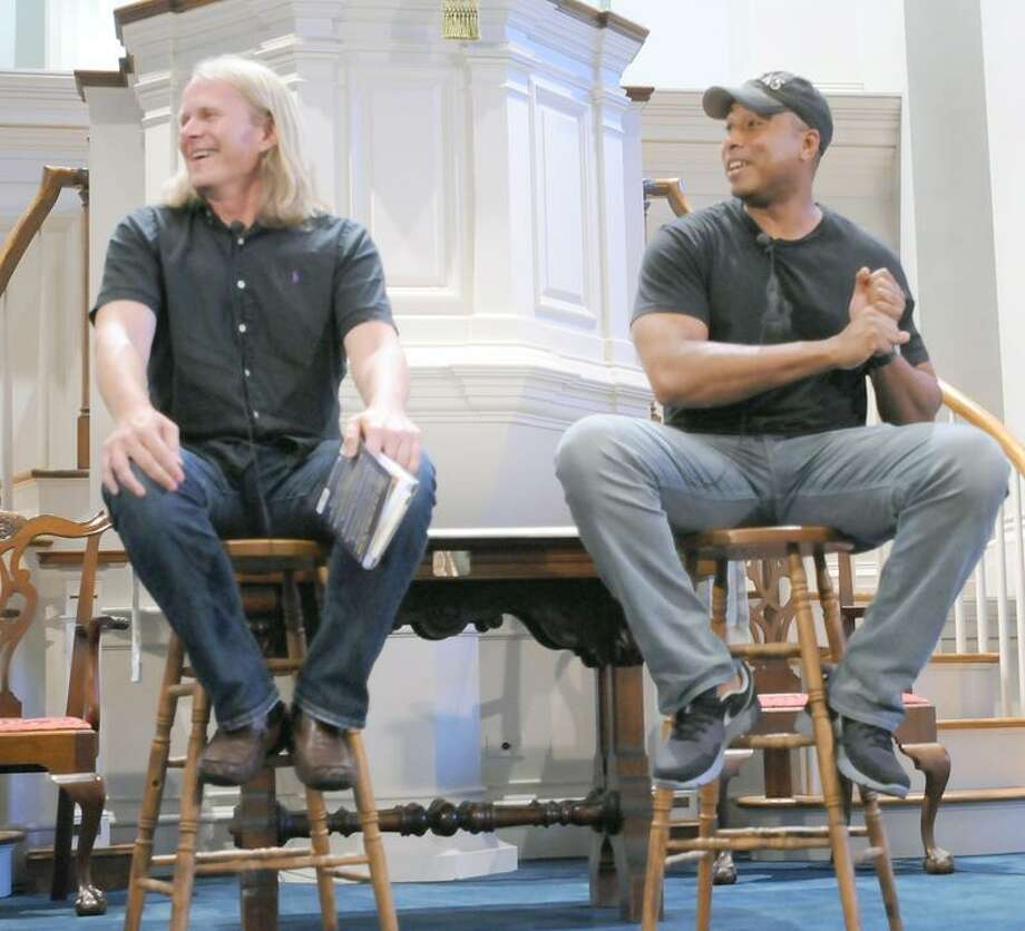"""Bob Thompson, left, and Bernie Williams answer questions from the crowd at First Congregational Church in Madison last week. They were there through R.J. Julia Booksellers to promote their book """"Rythms of the Game"""".  Melanie Stengel/Register"""