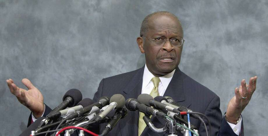 In this Nov. 2 file photo Republican presidential candidate Herman Cain speaks on Capitol Hill in Washington. Cain's Iowa campaign chairman is telling The Associated Press that the candidate is reassessing his presidential campaign a day after an Atlanta businesswoman alleged a 13-year extramarital affair with the Republican. (AP Photo/Carolyn Kaster, File) Photo: AP / AP