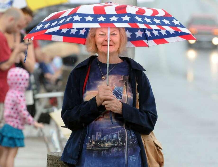 Parade spectator Mary Moran of Naugatuck has just the right umbrella for the occasion.(Mara Lavitt/Register)