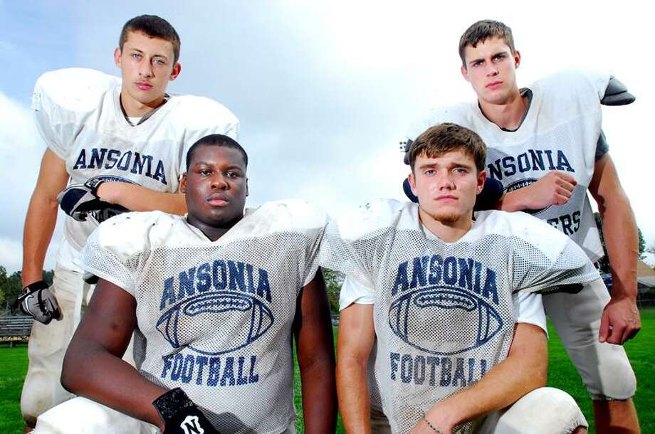 Ansonia football captains (left to right), Jake LaRovera, Hakeem Martin, Tyler Wood and Elliot Chudwick are photographed at Nolan Field in Ansonia on 9/27/2011.Photo by Arnold Gold/New Haven Register    AG0425D