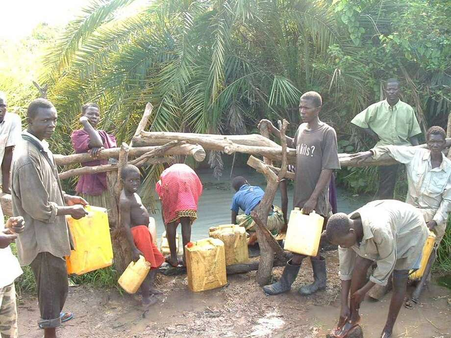 The Omua Village water source before a well funded by local Rotary clubs and Call to Care was built. (Contributed photo)