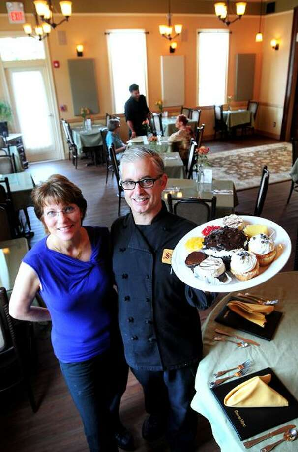 Lisa Stockbridge and her husband, Brian, are photographed in their new eatery, Stockbridge's New England Bistro & Bakery in Woodbridge. (Photo by Arnold Gold/New Haven Register)
