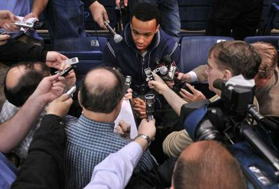 Storrs--Freshman Shabazz Napier speaks to the media prior to practice at Gampel Pavilion Tuesday.  Photo by Brad Horrigan/New Haven Register-03.29.11.