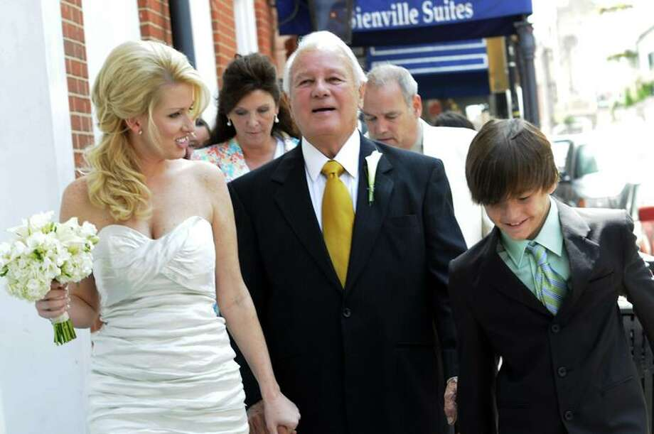 Trina Grimes Scott and former Louisiana Gov. Edwin Edwards walk down Bourbon Street after their wedding in the French Quarter in New Orleans Friday.  Associated Press Photo: AP / FR78279 AP