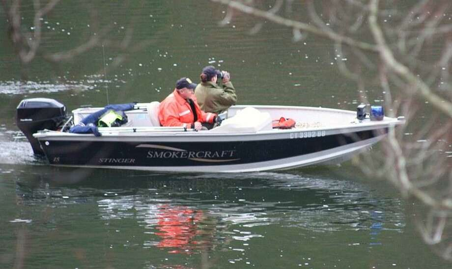 Rescuers search the Housatonic River Tuesday morning. Jean Falbo-Sosnovich/For the Register.