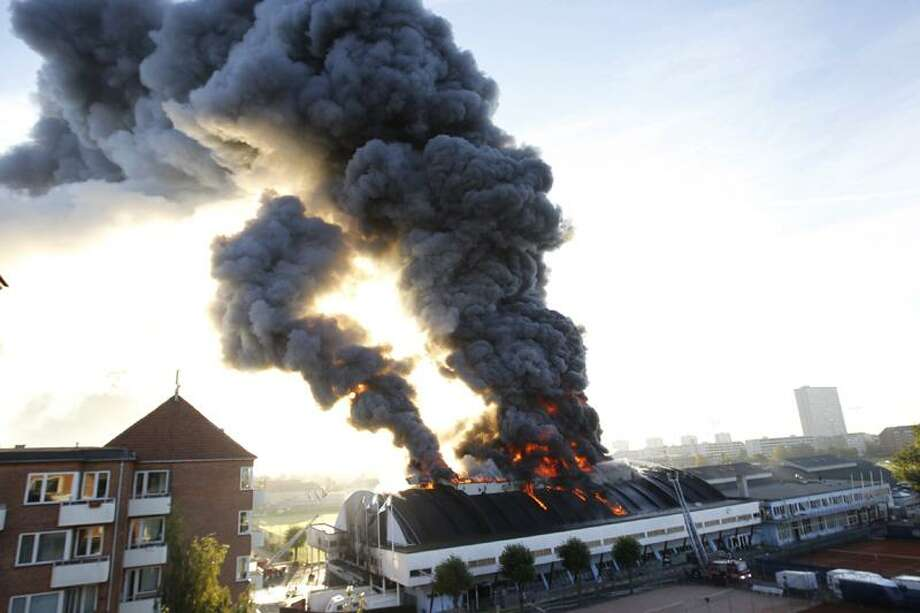 A fire raced through a 73-year-old sports arena in Copenhagen Wednesday, destroying the iconic building just hours before a sex fair was to open, officials said. About 20 people involved with the erotic trade fair, who were sleeping inside the K.B. Hallen arena when the blaze started, got out safely. The blaze most likely started when overheated light bulbs set fire to nearby cardboard boxes inside the 1938 arena, a police spokesman said. Associated Press