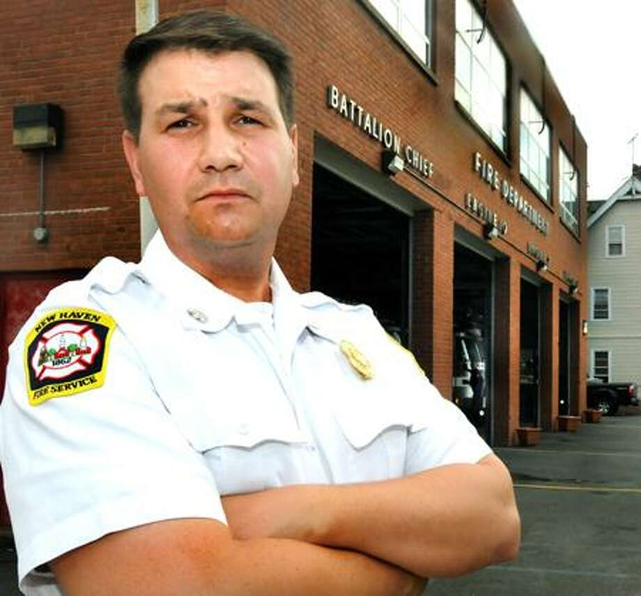 Fire Lt. Frank Ricci stands outside the fire station on Lombard Avenue in New Haven Thursday. Melanie Stengel/Register