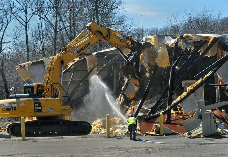 Branford--A garage at the Public Works facility in Branford being demolished Monday. Photo by Brad Horrigan/New Haven Register.