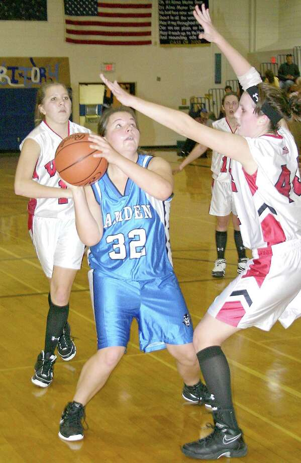 Submitted Photo by JON RATHBUN  Camden's Michelle Wishart (32) looks to shoot over VVS' Leanne Doolen, right, in the opening game of the Dolgeville Tournament Saturday, November 26, 2011. Red Devils point guard Marissa Randall backs up the play. The Blue Devils won 53-48.