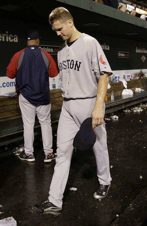 Boston Red Sox relief pitcher Jonathan Papelbon walks out of the dugout after the Red Sox's 4-3 to the Baltimore Orioles in a baseball game Wednesday, Sept. 28, 2011, in Baltimore. (AP Photo/Patrick Semansky) Photo: AP / AP2011