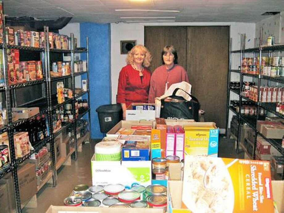 SUBMITTED PHOTO Mary Vetter and Sue Hartfield deliver food to the Verona Food Pantry.