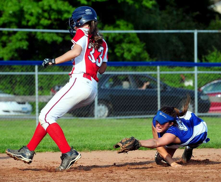 Rebeka DeRosa (left) of Foran gets by the tag of Shannon Connor (right) of West Haven and steals second base in the third inning of their SCC semifinal game in West Haven on 5/28/2011.Photo by Arnold Gold/New Haven Register     AG0412F