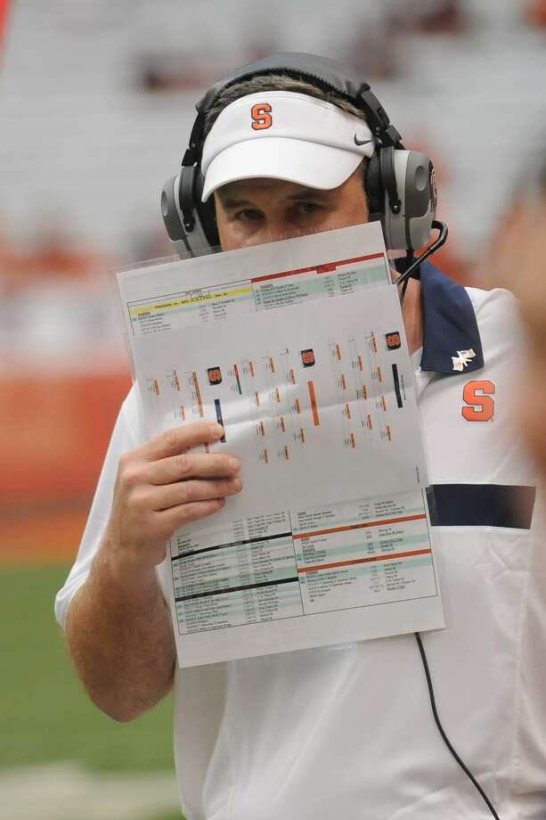 Syracuse coach Doug Marrone calls in a play against Rhode Island during an NCAA college football at the Carrier Dome in Syracuse, N.Y. on Saturday, Sept. 10, 2011.  (AP Photo/Steve Jacobs) Photo: ASSOCIATED PRESS / AP2011