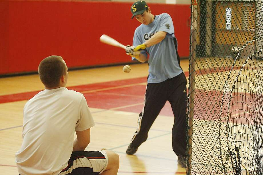 Dispatch Staff Photo by JOHN HAEGER VVS' Collin Laguzza, batting, and Jesse Whitmeyer work on a drill during practice on March 24, 2011. Some school sports are in danger of cutbacks or cuts next year and sacrifices are needed now from many groups to help improve the situation.
