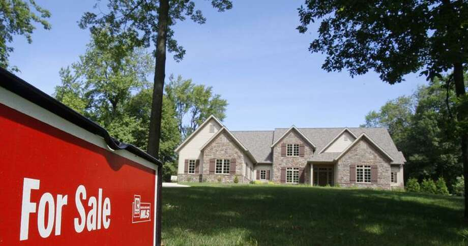 A new home is shown for sale, in Pepper Pike, Ohio. Sales of new homes fell to a six-month low in August. The fourth-straight monthly decline during the peak buying season suggests the housing market is years away from a recovery.(Associated Press file photo) Photo: AP / AP2011