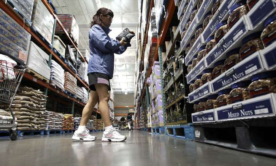 A shopper reads a product label at Costco Wholesale in Mountain View, Calif. Consumers' confidence in the economy remained weak in September after dropping to a post-recession low during the month before as Americans continue to worry about high unemployment and low wages.(Associated Press file photo) Photo: AP / AP2011