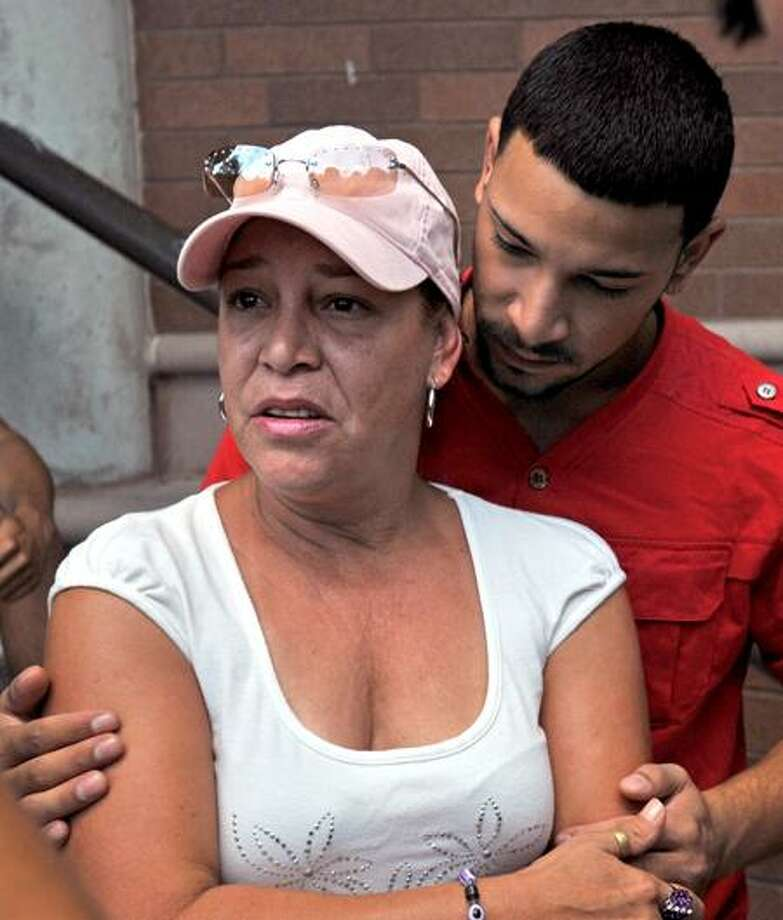 Luis Roman's sister, Blanca Candelaria, and her son, Roberto O'Neill, are seen outside Superior Court in Meriden after Roman's arraignment Wednesday. Brad Horrigan/Register