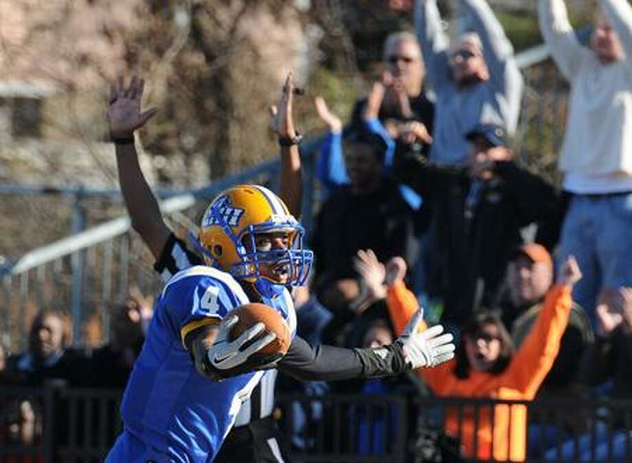 New Haven--UNH's Jason Thompson reacts after his first TD against Kutztown during the second quarter. Thompson had 3 TD's in the second quarter.  Peter Casolino/New Haven Register11/26/11