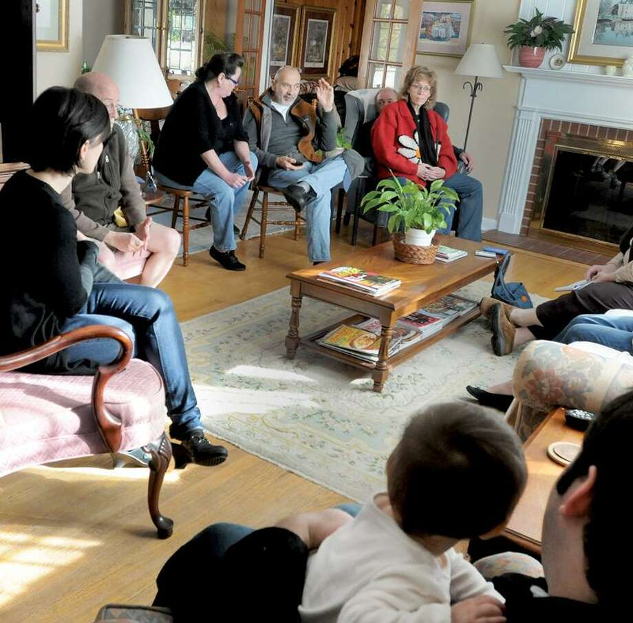 Residents who live in the Austen Road area discuss the bad behavior and public distrubances of some Quinnipiac University students living off campus and on and around their streets. Clockwise from bottom right are: Eliad Laskin with his daughter Maya Laskin, 1, Deb Flonc, John Moynihan, Lynn Mudry, David Kiljanowicz, Dick and Sherry Craft. Peter Hvizdak / Register    November 19, 2011   ph2412       Connecticut / PETER HVIZDAK