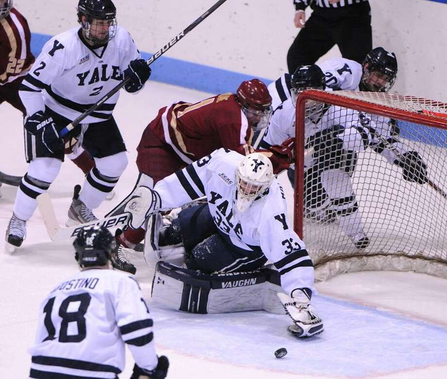 New Haven-- Yale Goalie Jeff Malcolm makes the stop during the first period.   Peter Casolino/New Haven Register   11/26/11