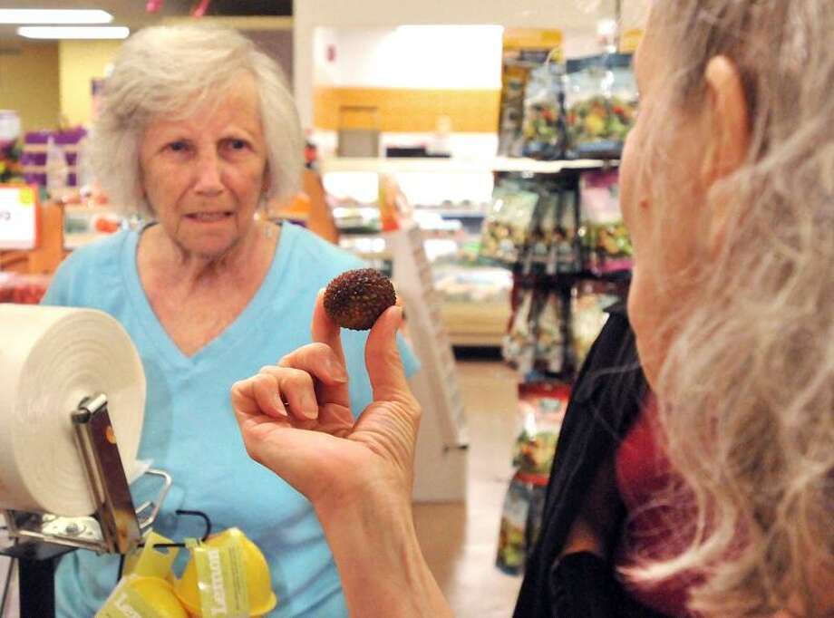 "Dr. Emily Nolfo introduces Diane Brady and other patients to lychees at a Branford Stop & Shop during ""Shop with the Doc."" Brad Horrigan/Register"