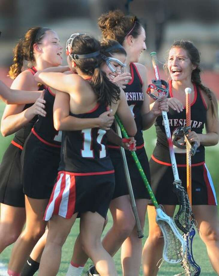 SPORTS_Cheshire celebrates after defeating Hand in the SCC Championship.At center, wearing glasses is Alyssaa Hague, who scored the winning goal.   Melanie Stengel/Register
