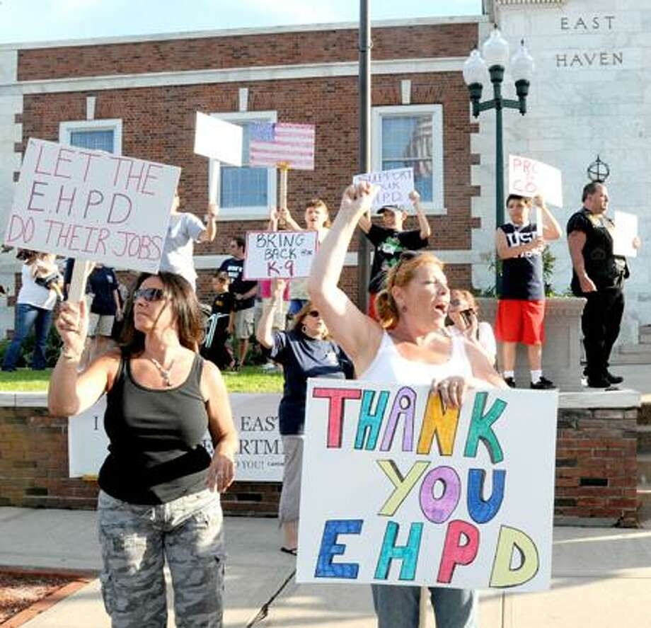 Demonstrators rally in front of East Haven Town Hall Wednesday evening to show support for the police department, claiming Mayor April Capone does not support the department. Peter Hvizdak/Register