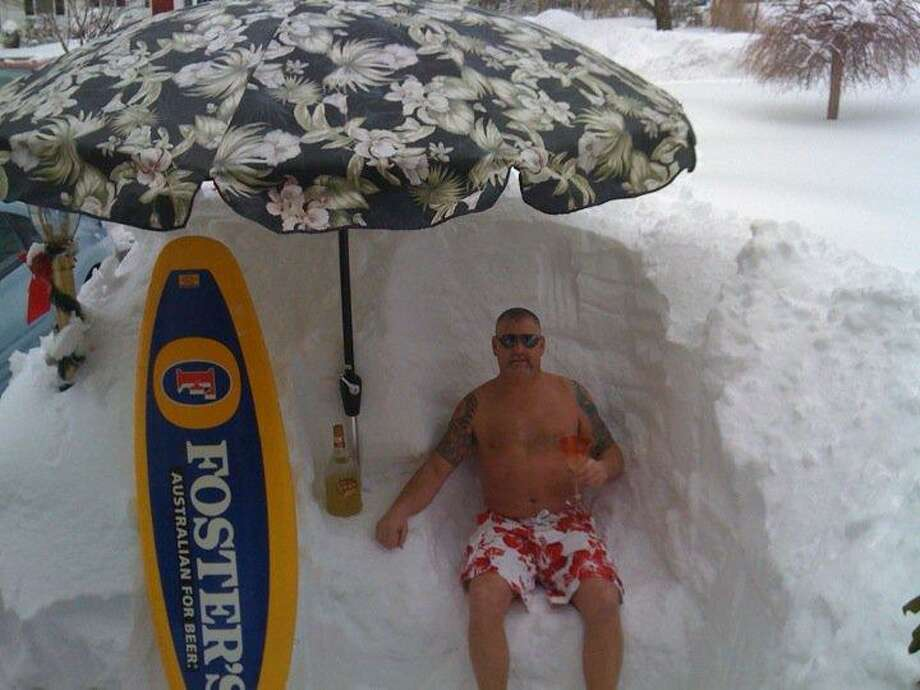 "Jacqueline M. Bashar of Shelton sent this photo, quipping, ""After a long morning of shoveling who doesn't need a seat and a cold one."""
