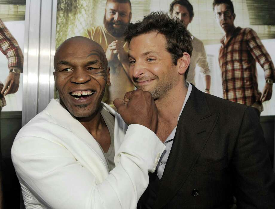 """""""The Hangover Part II"""" cast members Mike Tyson, left, and Bradley Cooper pose together at the premiere of the film, Thursday, May 19, 2011, in Los Angeles. (AP Photo/Chris Pizzello) Photo: ASSOCIATED PRESS / AP2011"""