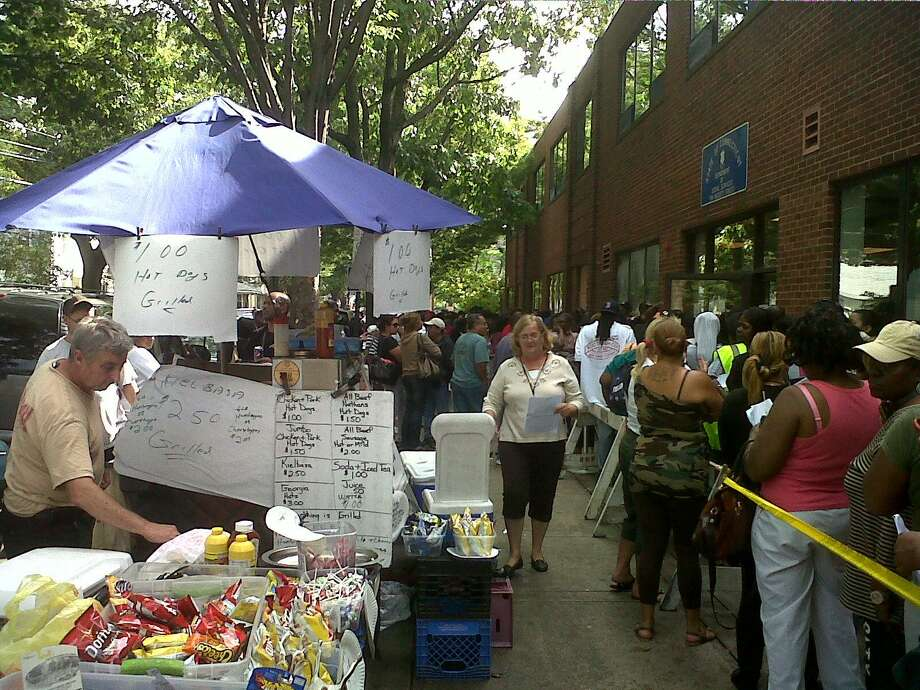 Folks lined up in New Haven trying to sign up for post-Irene food aid.  Photo by William Kaempffer