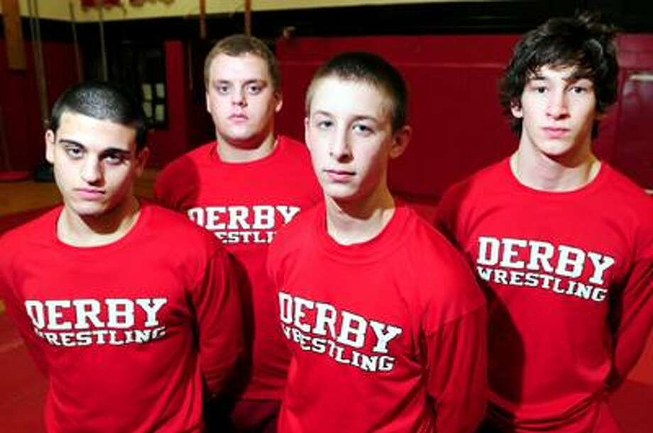 Left to right - Derby High School wrestling captains Anthony DiChiara, Jesse Gilbert, Kyle Russell and Jake Piazza are photographed in the school's gym on 1/25/2011.Photo by Arnold Gold/New Haven Register       AG0400F