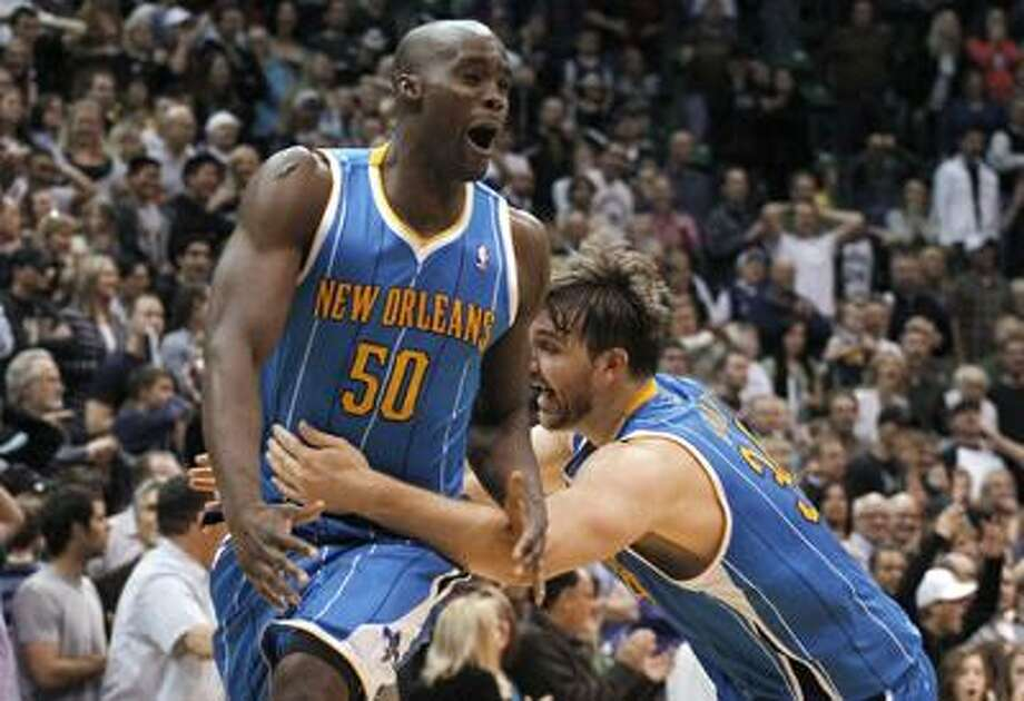 New Orleans Hornets' Emeka Okafor, left, and Aaron Gray react after Okafor hit a shot that sent the NBA basketball game into overtime on Thursday, March 24, 2011, in Salt Lake City. The Hornets won 121-117. (AP Photo/Jim Urquhart) Photo: AP / Jim Urquhart/Straylighteffect.com
