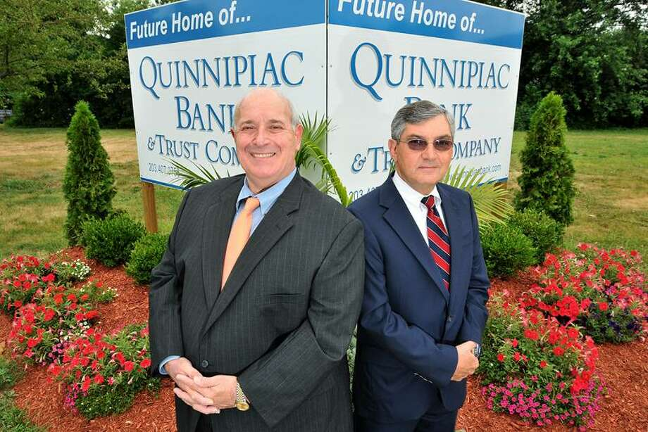 Quinnipiac Bank President and CEO Mark Candido and Executive Vice President Dick Barredo stand at the site of their bank's new headquarters in Hamden. The bank announced Monday that it became profitable in the second quarter. The company has bought land at 2704 Dixwell Ave., where its new headquarters will be. The bank is currently located nearby, elswhere on Dixwell Avenue.  Brad Horrigan/Register