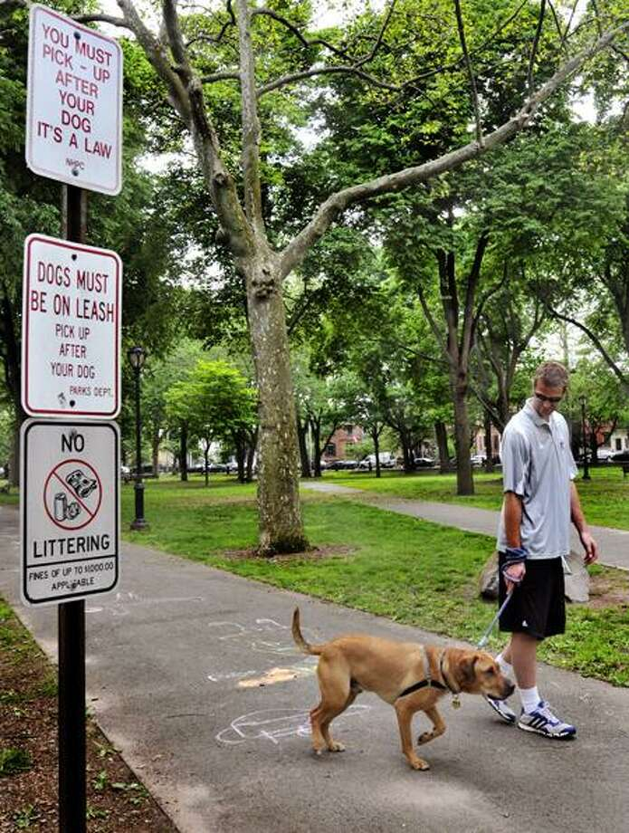Russell Battistoni walks his dog, Fletcher, in Wooster Square Thursday in New Haven. Melanie Stengel/Register