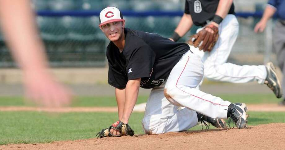 SCC baseball semi-finals at Yale Field: Cheshire's pitcher Ryan Rougeot watches the action at first after getting hit by a line drive in the leg in the second inning. Rougeot stayed in the game and earned the win. Photo by Mara Lavitt/New Haven Register  5/26/11