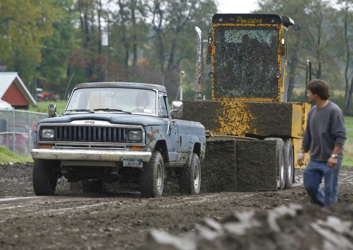 Dispatch Staff Photo by JOHN HAEGER twitter.com/oneidaphotoTJ Proctor of Richfield Springs compete in the truck pull driving a 1984 Jeep during the 40th Wheel Days in Brookfield on Saturday, Sept. 24, 2011.