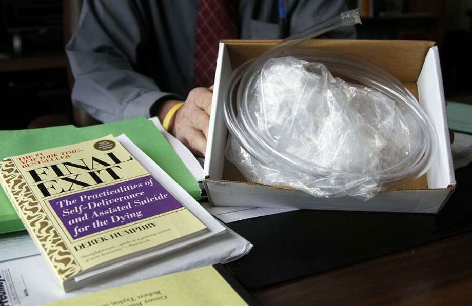 "This is the  ""suicide kit"" consisting of the book ""Final Exit,"" tubing and a plastic bag with collar that fits over a person's head. Associated Press Photo: AP / AP"