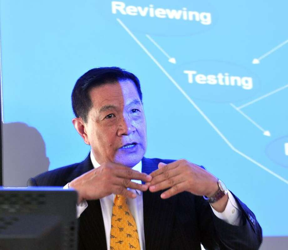 Henry C. Lee talks to police chiefs, detectives and forensics experts from around the state about new technologies available to them during a seminar at the Henry C. Lee Institute at the University of New Haven. Peter Casolino/Register