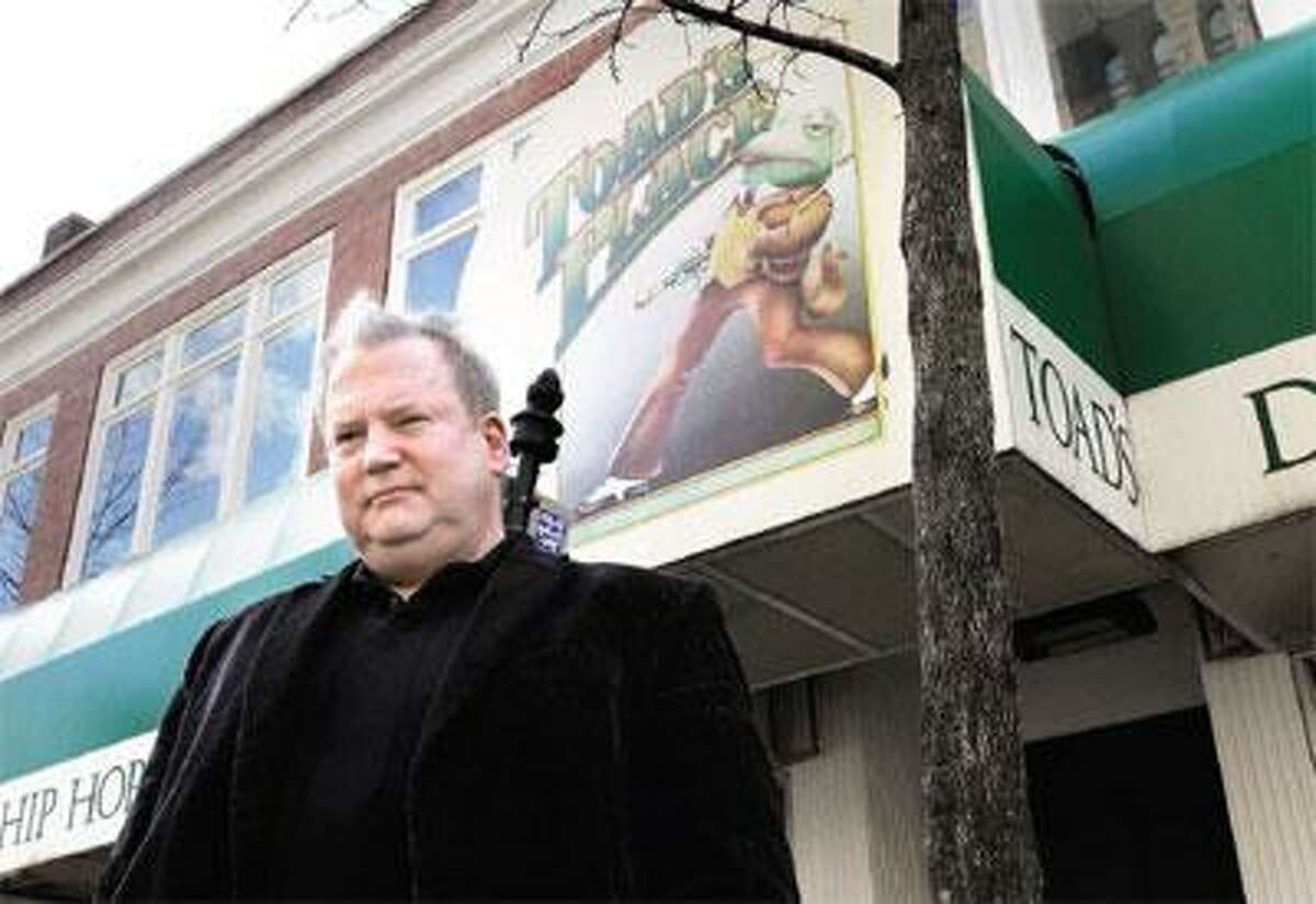 Brian Phelps, owner of Toad's Place, stands in front of the club on York Street in New Haven Thursday. (Mara Lavitt/Register)
