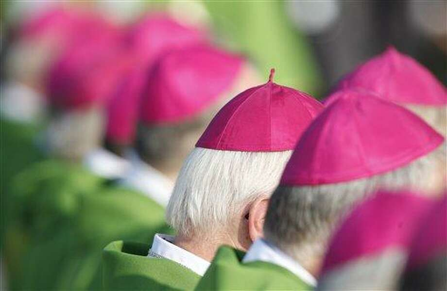 Bishops attend a mass celebrated by Pope Benedict XVI in Freiburg, Germany, Sunday, Sept.25, 2011, the last day of a four-day-visit to his homeland Germany.(AP Photo/Andrew Medichini) Photo: AP / AP